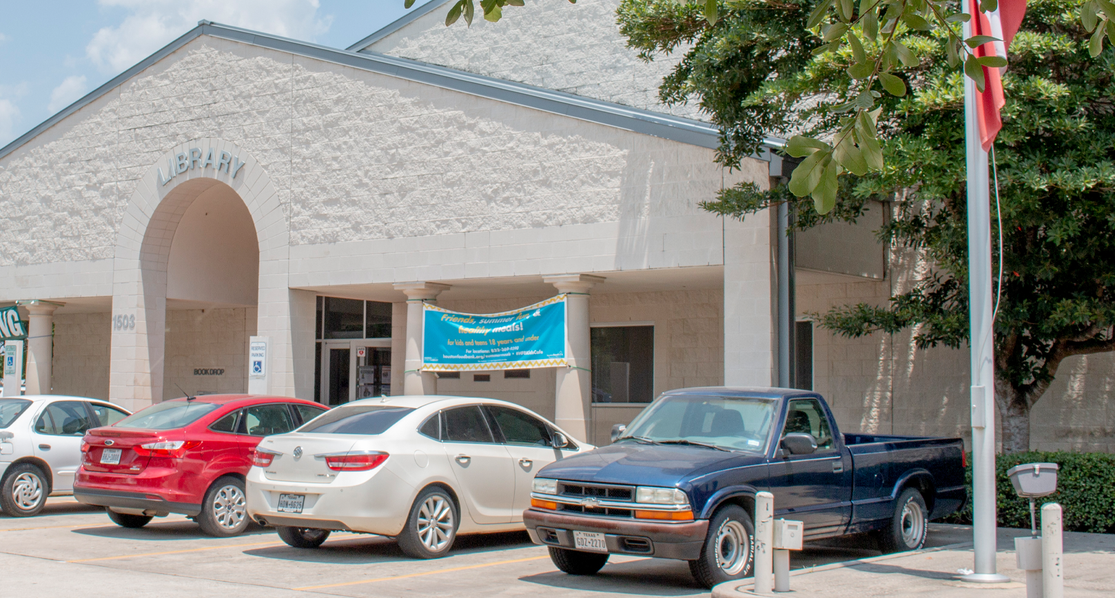 exterior of Octavia Fields Branch Library with cars parked