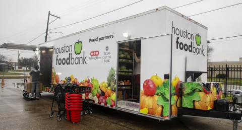 Houston Food Bank truck unloading Summer Reading Kids Cafe to Go meals