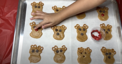 Cookie sheet with reindeer cookies and little helping hands